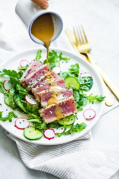 Low Carb Recipes To The Prism Weight Reduction Program This Panko-And-Sesame Crusted Seared Tuna On A Bed Of Arugula And Spinach, All Topped With A Wasabi Butter Sauce, Takes Japanese Food To Whole New Level Seared Tuna Salad, Seared Ahi, Ahi Tuna Salad, Fish Salad, Arugula Salad, Healthy Recipes, Salad Recipes, Cooking Recipes, Ww Recipes