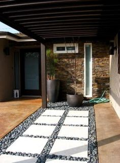 Nice definition of space with matching stones and window framing.  Good for front patio?