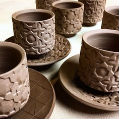 sneak preview of arabic coffee cup and saucer sets. these patterns are complicated and take SO long to carve! but I really like them, and I hope my hands (and eyes) can bear the torture! #clay #ceramics #pottery #earthenware #terracotta #carvingclay #pattern #islamicpattern #cupandsaucer #arabiccoffee #standardclay #shimpo #kempertools #artistresidency #uae #fujairah #workinprogress