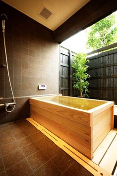 I imagine a big round wooden soak tub, but this one is nice too. Looks like it's insulated to keep the water hot.
