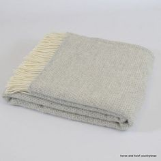Tweedmill Lifestyle Pure New Wool Beehive Throw - Grey A beautiful high quality throw ideal for the bottom of a bed, a throw for a chair or sofa or simply as a traditional blanket to keep you warm and comfortable on cold wintry night.  Available in two sizes:- Full size 150 x 183cm Knee Rug 70 x 183cm  Tweedmill Textiles of Wales - woven in Denbigh on the edge of the Clwydian mountain range in North Wales, an area steeped in textile history and inspirational natural materials.  The…