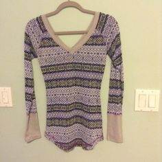 Free People Deep-V Thermal Beautiful blouse worn a few times. Great condition and from a smoke and pet free home. Free People Tops