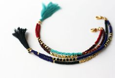 Beaded Tribal Bracelet - Friendship Bracelet - Tassel  Bracelet - Double Strand Bracelet by feltlikepaper on Etsy