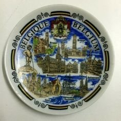 Vintage Old Porcelain Belgium RARE Handmade Hand Paint Decor Hanging Wall Plate small ART small Plate with a diameter of (10) cm . Draw archaeological sites and landmarks in Belgium and write their names under each drawing.A special piece for anyone who loves such rare artifacts is kept or given to his distinguished friends