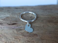 The sterling silver floating heart stacking ring can be worn as a reminder that you are loved, to be open to being loved and to spread love. Silver Stacking Rings, Sterling Silver Rings, Gold Jewellery Design, Gold Jewelry, Everyday Rings, Tiny Heart, Dainty Ring, Love Ring, Etsy Jewelry