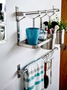 Need a cup of joe in hand to keep the morning running smoothly? This kitchen shelf & rail set makes the perfect spot for resting a cup while doing makeup (plus the caddies are great for storing toiletries, too)