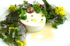 Goat Cheese Panna Cotta with Peas, Spring Onions, Petite Greens, and Blossoms | CUESA