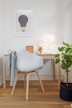 Home office with an About a Chair chair by Hay via the Design Chase.