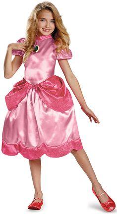 Disfraz Princesa Peach™ niña : Este disfraz de la princesa Peach™ para niña tiene licencia oficial Mario™. Incluye vestido (zapatos no incluidos).El vestido de Peach es rosa palo y tiene manga corta con efecto...