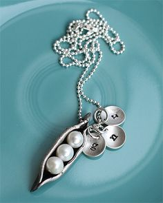 3 peas in a pod with the initials of my kids - the vintage pearl...I so want this!!!