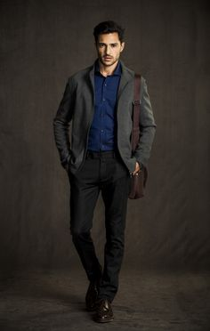 Monochrome look: grey blazer, black/dark grey pants.  Blue dress shirt to make it pop.  The brown bag is a similar dark shade to the grey and black, so does not interfere with monochrome