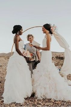 Romantic wedding photo of a Lesbian wedding ceremony | Utterly Romantic Las Vegas Desert Elopement Inspo - Love Inc. Mag -JAMIE Y PHOTOGRAPHY Romantic Wedding Photos, Romantic Updo, Lesbian Wedding, Bride Look, Equality, Wedding Ceremony, One Shoulder Wedding Dress, Las Vegas, Deserts