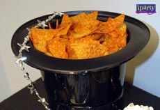 Top Hat Snack Bowls   Use a plastic top hat as a serving bowl. Fill with chips or other dry foods
