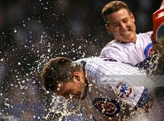 Kris Bryant of the Chicago Cubs gets a Gatorade shower from teammate Anthony Rizzo after he hit a game-winning, two-run home run in the bottom of the inning against the Colorado Rockies at. Cubs Win, Go Cubs Go, Chicago Cubs Baseball, Colorado Rockies, National League, Cincinnati Reds, Baseball Cards, Cubbies, Bud