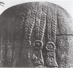 The back of an Olmec sculpture with cornrows.