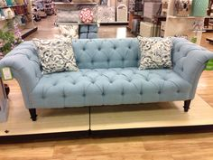 Blue tufted sofa looks like its from pier one imports  Oh this just makes me happy!!