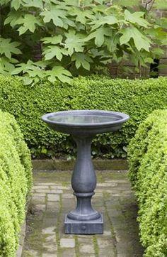 http://www.thegardengates.com/williamsburg-candlestand-bird-bath-cast-stone-p7925.aspx