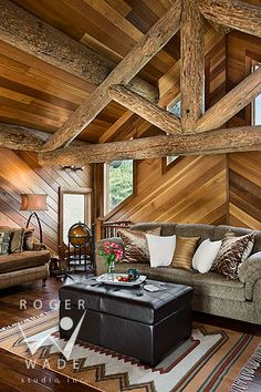 I like the lines in the background. It draws the eye in and centers the room.  roger wade studio interior photography of loft sitting area with diagonal wood paneling, private log home, woolwich, maine, by precision craft log & timber homes