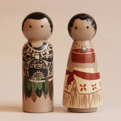 A set of 2 hand painted wooden peg dolls depicting Moana and her demi-god friend, Maui. Wonderful attention to detail! Create the magic of play for children with these beautifully hand painted and Waldorf-inspired, original Peg Doll Creations!