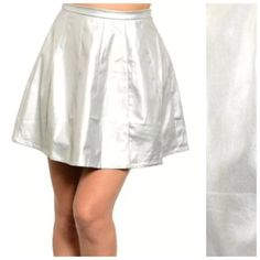 """Metallic Silver Faux Vegan Leather Skirt Small ‼️ PRICE FIRM UNLESS BUNDLED WITH OTHER ITEMS FROM MY CLOSET ‼️   Size Small (runs small)   ABSOLUTELY GORGEOUS! Soft faux leather.  55% polyester, 45% polyurethane. Lining is 100% polyester. Metallic silver with black floral brocade print.  This skirt runs small so please check the measurements.  Please check my closet for many more items including scarves and jewelry.  Waist 24""""  Length 17"""" Ark & Co Skirts"""