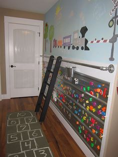Amazing activity wall! Magnetic board on the bottom, colored chalkboard paint on top, and a rolling ladder!