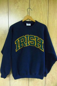 Vintage Notre Dame Fighting Irish Sweatshirt by GrampasVintageShop Hoodie Sweatshirts, Basketball Sweatshirts, Crew Neck Sweatshirt, College Outfits, School Outfits, College Style, Dope Outfits, Fall Outfits, Notre Dame Apparel