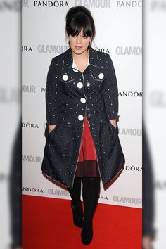 Welcome back Lily! The British pop star made a rare public appearance in an adorable polka dot coat.