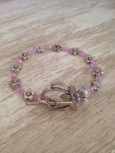 Beautiful pink beaded bracelet with Swarovski beads and tibetan silver by PinkPixieVintage on Etsy https://www.etsy.com/listing/472164137/beautiful-pink-beaded-bracelet-with