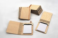Wow! This is truly nice, an all wooden booklet-holder. Lasercutting at its finest.