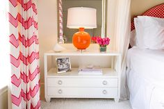 Chic girl's room features white and red lattice headboard next to mirror over white lacquered nightstand filled with orange lamp as well as white and pink chevron curtains. Chevron Curtains, Boudoir, Mirrored Nightstand, Big Girl Rooms, Kids Rooms, Teen Rooms, Baby Rooms, Room To Grow, Child Room