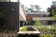 Buytengewoon villatuinen architectonische bostuin met