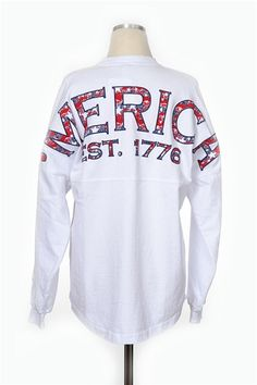 Theyre here Our Merica Spirit Jersey is perfect for every day of the year A long sleeved over sized tee with a screen printed back. How perfect will this top be with jean shorts and sunnies An additional 7 added to order for monogramming fees. Spirit Jersey, Summer Outfits, Cute Outfits, Sweater Shirt, Passion For Fashion, Dress To Impress, Preppy, Fashion Outfits, Graphic Sweatshirt