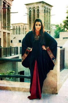 This UAE abaya style is so pretty with the traditional embroidery accents