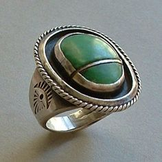 An Impressively Large 1-3/16 Old Pawn Vintage Native American Navajo Ring Entirely Handcrafted with a Bezel-set Natural Green From Years After Antique and Vintage Jewelry on Ruby Lane