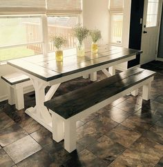 Country/Rustic Dining table with 2 matching benches. All tables/benches are made to order and can be your dimensions or our standard. They are also priced for your color/stain choice upon ordering. Visit us at www.knottybotcreations.com for more products and information.