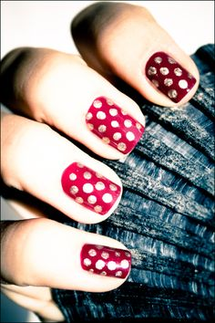 Dotted red and gold nails