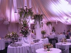 I love how drapey/dreamy everything is...definitely wouldn't want the purpley lighting and I would go with a different flowers and centerpieces...but the feel of it is nice:)