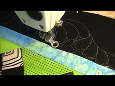 Long arm quilting feathers on Easy Street quilt - YouTube