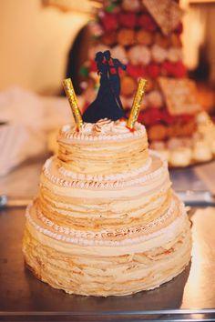 multi-layered wedding cake, photo by Joyeuse Photography http://ruffledblog.com/french-castle-wedding #weddingcake #cakes