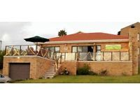 Lovely 2 bedroom/ 2 bathroom cottage with Open plan living area. Patio with beautiful sea view and built-in braai. Please send e-mail for more info! Dec rates R1200 per day!