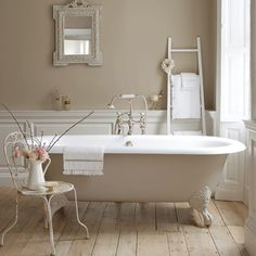 ( free-standing baths by Drummonds ) wooden floor panelling and wall color