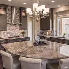 If the kitchen is the heart of the #home, make it skip a beat with the added drama of a chandelier! #designinspo