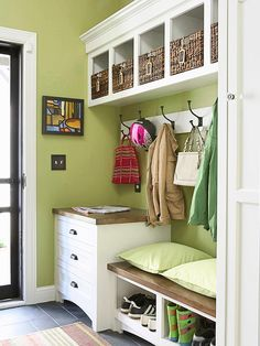 Using all components of a mudroom, this setup assigns space to everything you need in a drop-off and pickup spot. Shoes shuffle into floor-level compartments, and small items take their place in cabinet drawers. Wall hooks make places to hang coats and bulkier items, and the overhead compartments give homes to any stray belongings, such as mittens and hats in winter, and sunscreen and sunglasses in summer./