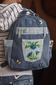 Blue denim Backpack beaded with cornflowers is very reliable, durable, capacious and stylish. The large outer pocket of a backpack I embroidered beaded flowers - cornflowers. And on the magical sight of these flowers flew few multicolored butterflies. Butterflies made of wood and hand-me schedule. A backpack has comfortable external and internal pockets. Inside you can find three useable pockets, one of them closing with zipper. On the sides backpack has external pockets, where you can put…