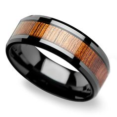 This black ceramic band frames an 8-millimeter inlay of reused koa wood creating an striking men's ring.