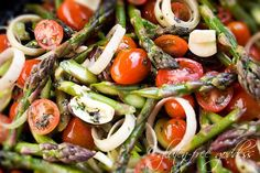 Asparagus and tomatoes on gluten free spring pasta