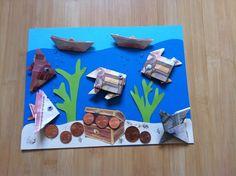 Gefaltete Fische aus Geldscheinen