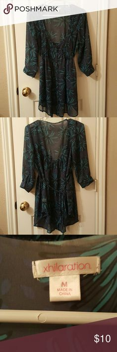 Sheer 3/4 Sleeve Blue-Green Print Blouse w/ Button Sheer 3/4 Sleeve Blue-Green Print Blouse w/ Buttons and Tie in Back by Xhileration. Pleats at chest area. Buttons down to the bottom. Long length. No tears, stains or snags. Size Medium. Would need to wear a camisole or tank top underneath. 100% Polyester. Xhilaration Tops Blouses