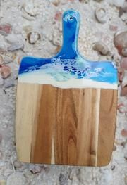 "These vibrant and creative resin cheese boards are a part of the resin homewares collection ""Abstract Earth Art"" where its original handmade artistic designs were created from. Drawing from Lisa's creativity each piece in her resin homewares collection has been handcrafted and created from her years of experimental tec Buy Resin, Wood Chopping Board, Resin Artwork, Lisa S, Cheese Boards, House Warming, Wedding Gifts, Vibrant, Creativity"