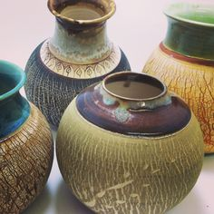 use sodium silicate do to pottery - for the crackled effect. Use constrasting colors